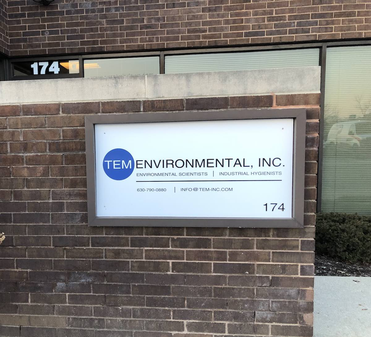image of TEM Environmental sign on front of office